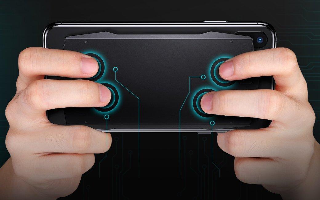 Геймпад Muja Smart Touchpad крепится к задней крышке смартфона и оснащен сенсорными клавишами | Канобу - Изображение 2